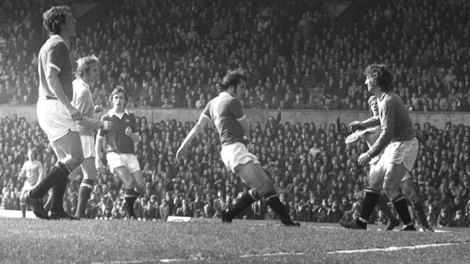 Denis Law (second left), formerly of Manchester United,  puts the seal on his old club's relegation with a back-flicked goal for Manchester City in the match at Old Trafford.  * Other players, all United, are from left: Houston, McIlroy, Holton and goalkeeper Alex Stepney.
