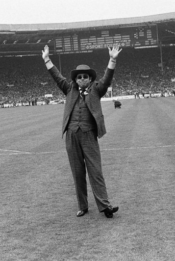 Watford chairman Elton John acknowledges the cheers of the crowd before the match